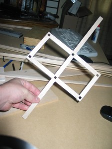 Built base. Notched 6 positions for frames using X-Acto knife.  Also note lateral stabilizing arms.