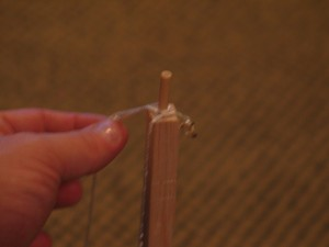 Sling release.  This is a small dowel peg at the end of the throwing arm where one end of the sling is tied, and the other is looped over the peg to slide off at the proper point.